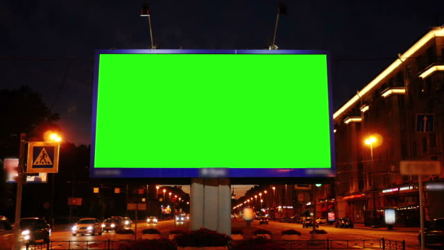 A Billboard with a Green Screen on a Busy  Street A Billboard with a Green Screen on a Busy  Street billboard stock videos & royalty-free footage