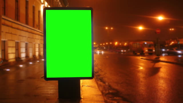 a billboard with a green screen on a streets - poster стоковые видео и кадры b-roll