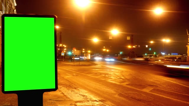 A Billboard with a Green Screen on a Streetы.Time Lapse. video