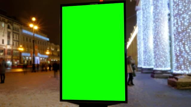 ein plakat mit einem grünen bildschirm - poster stock-videos und b-roll-filmmaterial