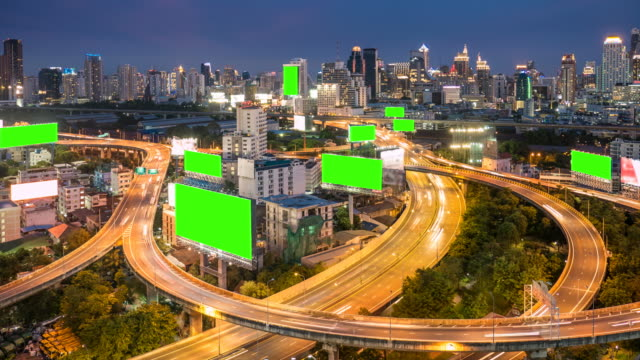 Billboard with green screen on HighWay at Dusk, Chroma key video