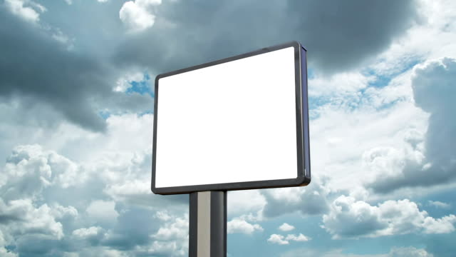billboard with moving clouds - poster стоковые видео и кадры b-roll