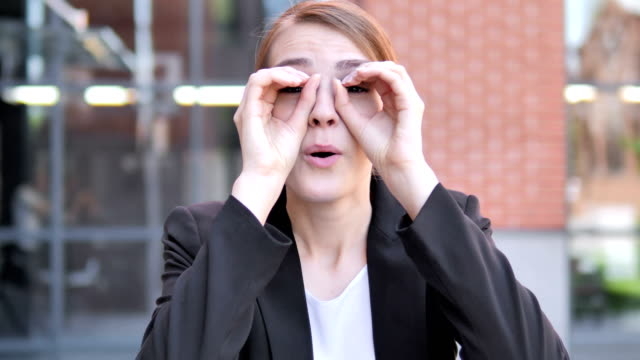 binocular gesture by young businesswoman - temptation stock videos & royalty-free footage