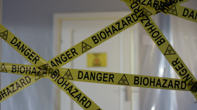 biohazard symbol Barricade Tape in Front of Coronavirus Contaminated Room