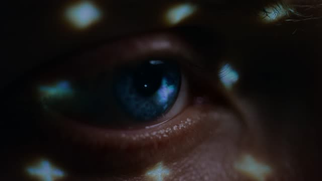 Biometric Facial Recognition Scanning of Blue Eye's Iris. Futuristic Concept: Projector Identifies Individual by Illuminating Face by Dots and Scanning with Laser. Close-up Shot Biometric Facial Recognition Scanning of Blue Eye's Iris. Futuristic Concept: Projector Identifies Individual by Illuminating Face by Dots and Scanning with Laser. Close-up Shot Shot on RED EPIC-W 8K Helium Cinema Camera. cyborg stock videos & royalty-free footage