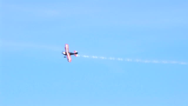 Biplane Trails Smoke Christen Eagle II Biplane flies over leaving trail of smoke.  propeller airplane stock videos & royalty-free footage