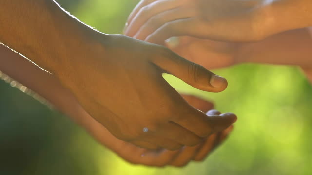 Biracial couple holding hands, giving oath to love forever, family creation Biracial couple holding hands, giving oath to love forever, family creation falling in love stock videos & royalty-free footage