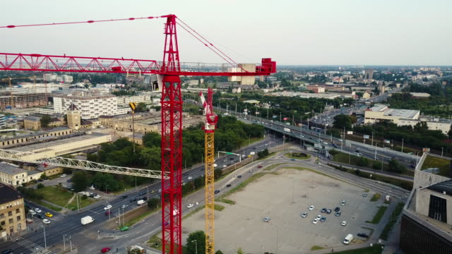 Bird eye view on construction site and crane - construction industry and development