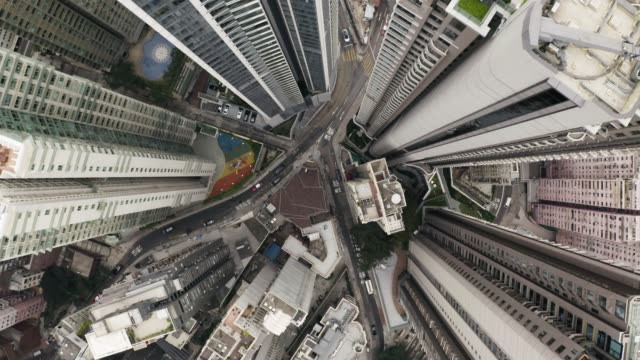 bird eyes view of hong kong cityscape from the drone. 90 degrees aerial view from drone of hong kong city. camera rotate moving from down to top. - in cima video stock e b–roll