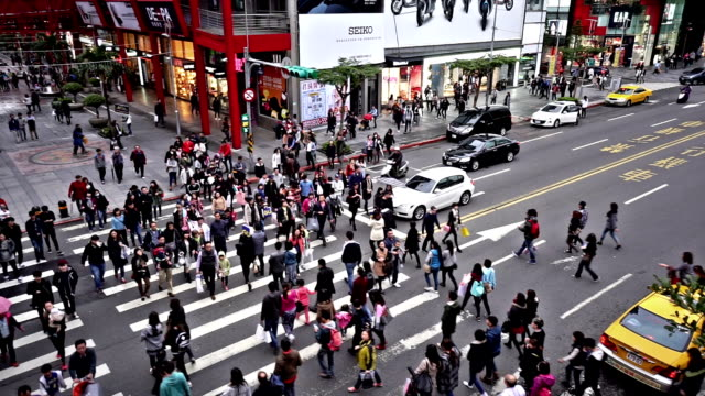 Bird view of the pedestrians go crossing the street in downtown, Taiwan, China video