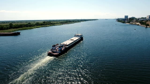 bird`s eye view of a long metal barge floating in the southern bug in summer - chiatta video stock e b–roll