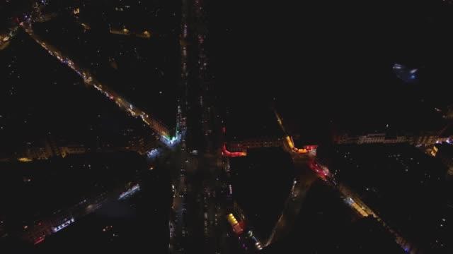Bird's eye view of beautifully lit Paris streets at night
