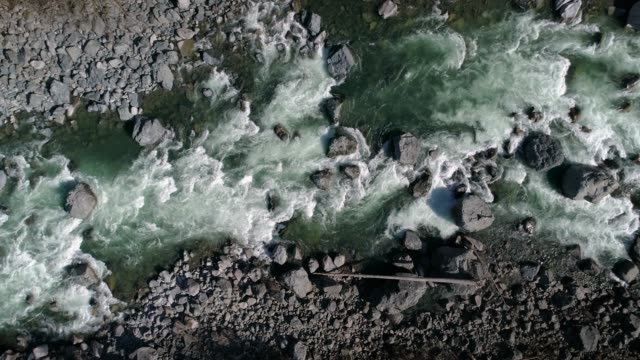 Birds Eye View Slow Motion River Background Aerial drone perspective flying above colorful raging rapids rapids river stock videos & royalty-free footage