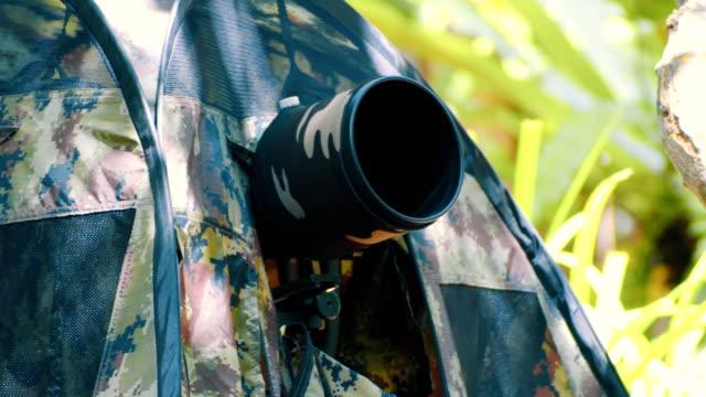 Birdwatcher taking bird photo – Video