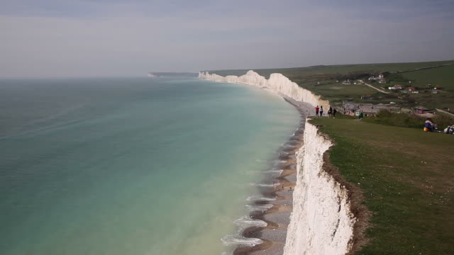 birling gap and the seven sisters chalk cliffs and beach east sussex england uk beautiful british coastline - south downs video stock e b–roll