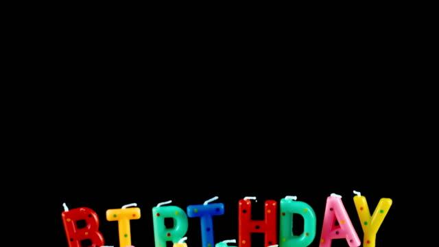 Birthday cake on a black background video