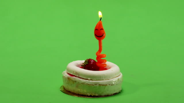 Birthday cake with candle. blown out. Ideal to represent birthdays, celebrations video