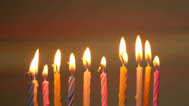 birthday candles. anamorphic flares - candeliere video stock e b–roll