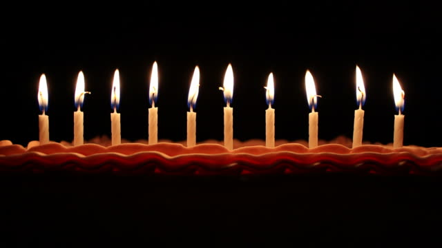 Birthday Candles Birthday candles are blown out and fade to black. candle stock videos & royalty-free footage