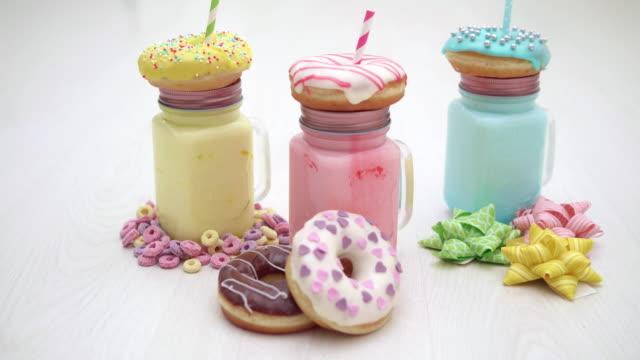 4K - Birthday dessert. Milkshake with Donuts video