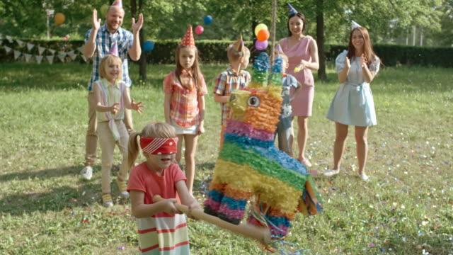 Birthday Girl Playing with Pinata video