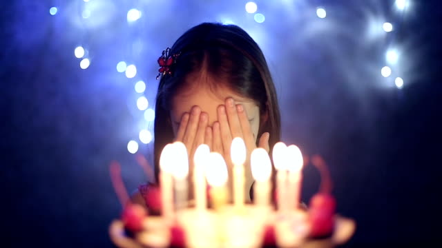 Birthday of female child she blows out candles on cake video