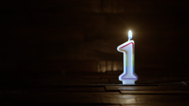 birthday or anniversary candle number one age concept - un singolo oggetto video stock e b–roll