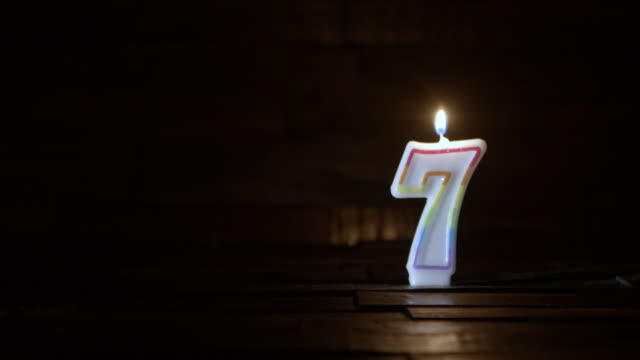 birthday or anniversary candle number seven age concept - 7 star stock videos and b-roll footage