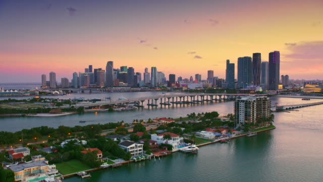 AERIAL Biscayne and Watson Island with Miami at sunset