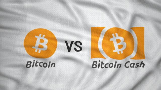 bitcoin vs bitcoin cash, crypto currency hard fork clash concept flag animated - icona posate video stock e b–roll