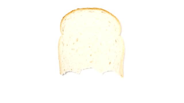 軽食からなっているスライスのパン、白色背景 - 食パン点の映像素材/bロール