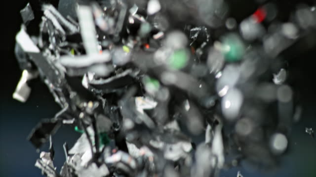 SLO MO Bits of shredded plastic falling down Slow motion close up handheld shot of bits of shredded plastic falling down. Shot in Slovenia. recycling stock videos & royalty-free footage