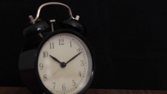 Black alarm clock on a black background