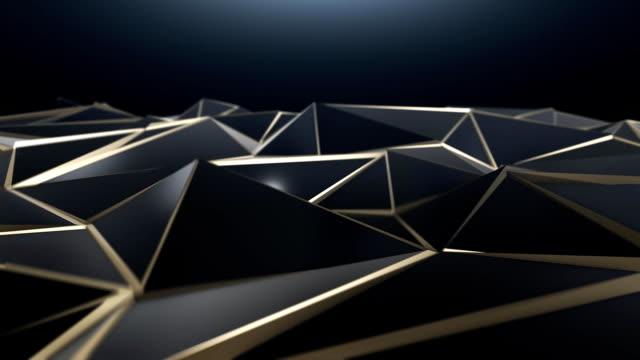 ブラックとゴールドの抽象的な低ポリ三角形の背景 - ローポリモデリング点の映像素材/bロール