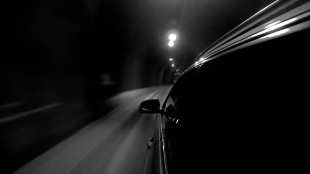 Black and white 4K footage of a car going through a tunnel at great speed video
