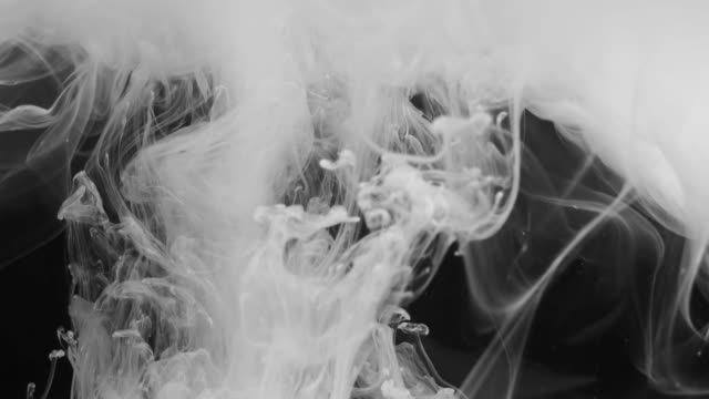 Black and white abstraction. Abstraction of white smoke on a black background. Whimsical forms of white color when mixing liquid. Magic background for chemistry, fortune telling, mysticism, biology. Black and white abstraction. east asia stock videos & royalty-free footage