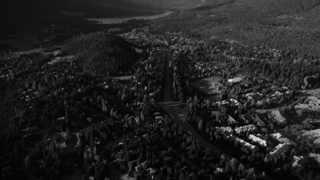Black and White Aerial of Sea to Sky Highway at Whistler in British Columbia Monochrome drone shot of Green Lake facing Pemberton in Canada black and white architecture stock videos & royalty-free footage