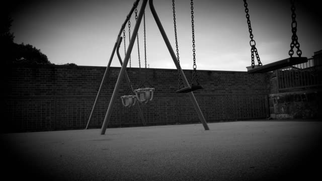 black and white creepy childs empty playground toy swings - child abuse stock videos & royalty-free footage