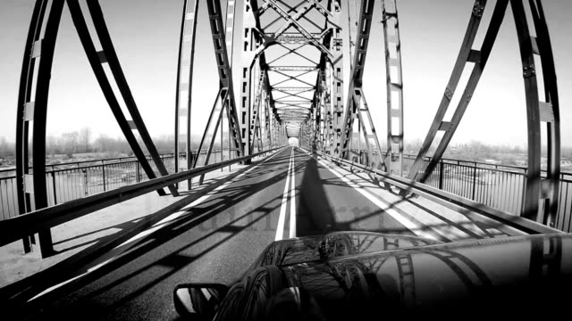 black and white footage: car is moving by the bridge - black and white architecture stock videos & royalty-free footage