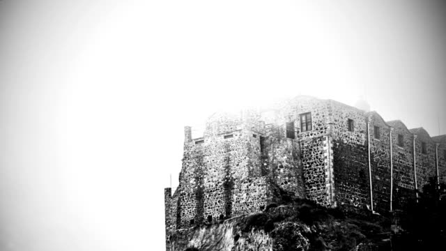 Black and white mysterious haunted castle standing on foggy top Black and white mysterious haunted castle standing on foggy top of mountain count dracula stock videos & royalty-free footage