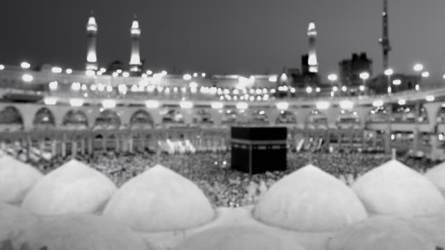 Black and white Saudi Arabia. Pilgrims circumambulate seven times to show their submission to the religion video