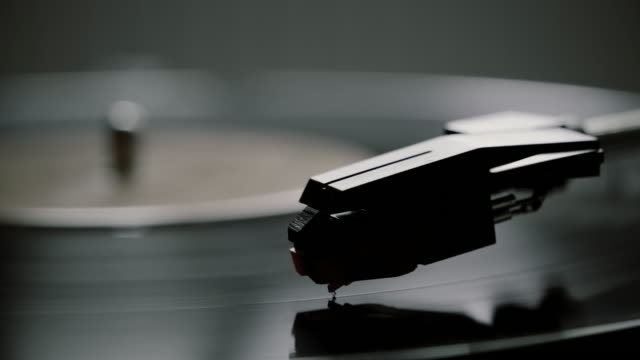 Video Black and white, stylus and record turntable.