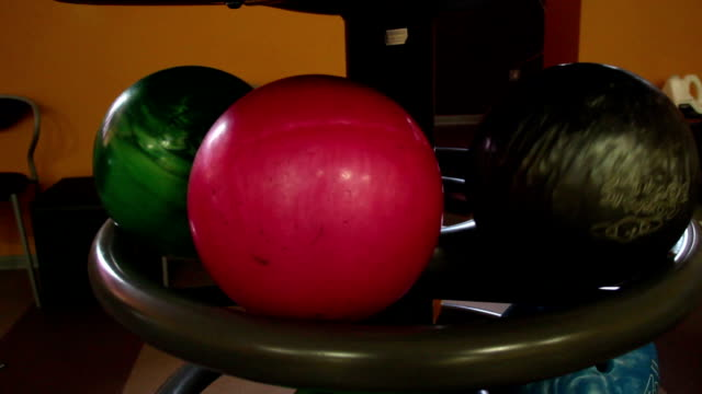 Black bowling ball rolling video
