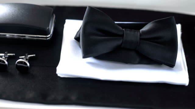 black bowtie on table. fashion background. - wedding fashion stock videos and b-roll footage
