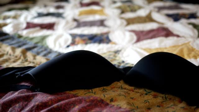 Black Bra lands on bedspread - Scandal concept video