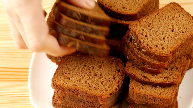 Black bread on the table. – Video