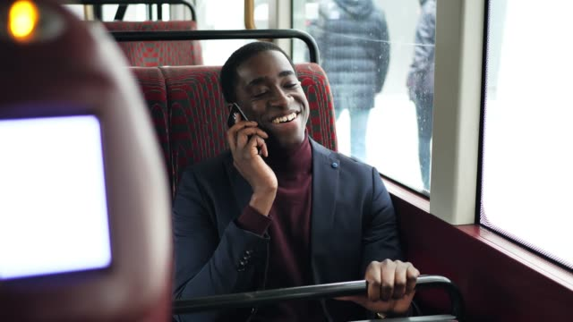 Black business person commuting talking on mobile phone