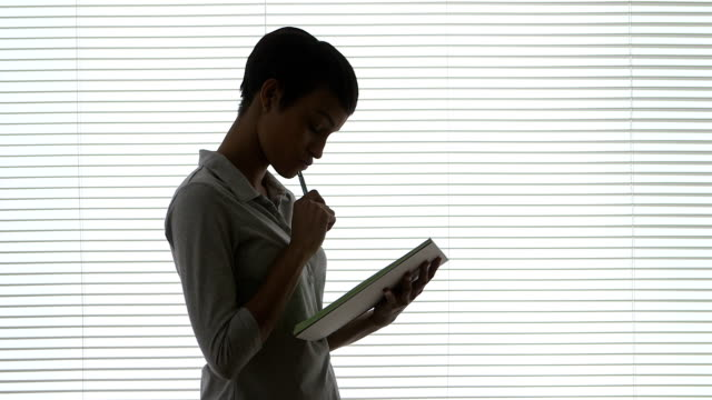Black Business woman taking notes in office video