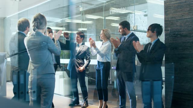 Black Businessman Got Big Promotion, Walking Path of Success, His Colleagues Cheer and Applaud. Stylish Diverse Office Filled with Happy People.
