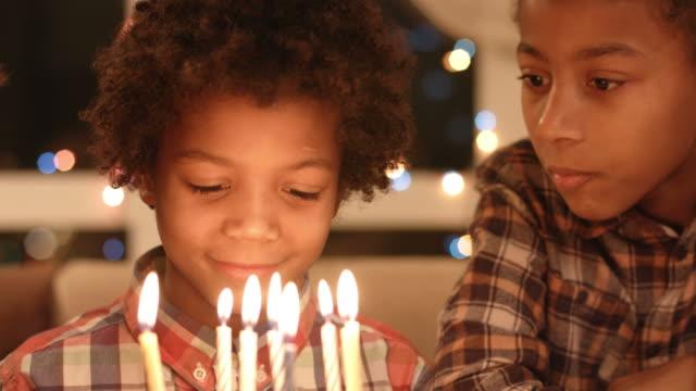 Black children with birthday cake. video